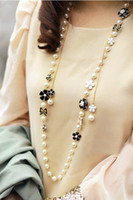 Wholesale Lovely Fashion Golden Metal Black White Enamel Flower Bowknot Pearl Long Chain Necklace