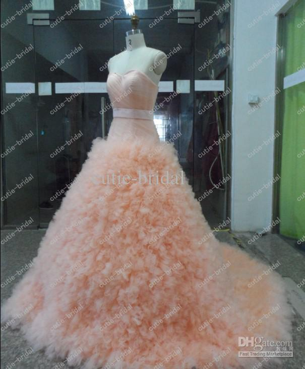 Blush pink wedding dress with tulle ruched skirt