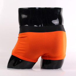Wholesale Hot Men s and Women s and Steel Boxers amp Briefs Black Trunk with Orange Bottoms International Brand Underwear