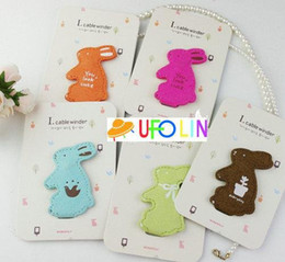 Wholesale cute rabbit humming roll up Moblie Earphone bobbin winder cable management