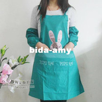 Wholesale Aprons waterproof rabbit embroidery pattern apron oversleeps raincoat fabric chromophous