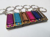 Kaine. Z Mini Keychain Harmonica 4 Hole 8 Tone Harmonica Keyc...