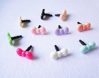 Wholesale New bowknot headphones hole dustproof plug headset dust hole plug general for iphone Samsung