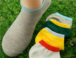 Wholesale the spring and autumn period and the double color screw type solid colored invisible cotton free size men socks pair