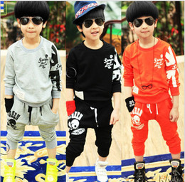 Wholesale 2013 autumn models of child sports suit new wave of fashion round neck skull POLO suit manufacturers