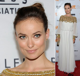 Wholesale Olivia Wilde dress featured sparkling gold embellishment accenting the neckline cuffs of sheer balloon long sleeves dubai women Dress