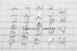 Wholesale initials letters A B C D E F G H I J K L M N O P Q R S T U V W X Y Z floating charms for memory living glass locket no glass locket