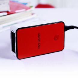Wholesale New arrival pass through Portable Office white collar gens desktop mini heater Mini heater hearter Warm hands warm air blower AAA
