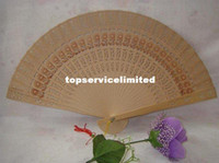 Wholesale cheap chinese carved folding fragrance wood hand fans