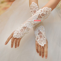 Bridal Gloves Wrist Length Ring Finger 2014The bride white tick refers to the long gloves stretch satin embroidered sequined dress accessories