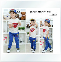 Cheap 2013 New Summer girls boys children clothing sports suit:Lovely boy superman short sleeve T-shirt+blue Casual pants