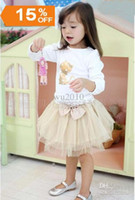 Wholesale Girls suits Girl golden cat long sleeved T shirt Bow gauze skirt Children s suits