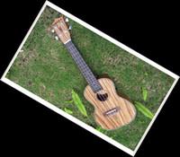 Wholesale New Ukulele ukulele inch Zebra wood Ukulele Hawaii small guitar free bag picks strings etc