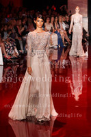 Reference Images Floor-Length A-Line 2014 Elie Saab Sexy Sheer Long Sleeves Chiffon Pageant Dresses Sequins Beaded Top Floor Length Backless Evening Gown BO2258