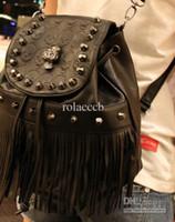 Wholesale new European and American fashion skulls rivets fringed single shoulder bag handbag bag backpack mini bucket
