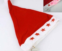 Wholesale 2014 Christmas LED flashing light christmas hat plush santa cap Non woven Hongkong Post