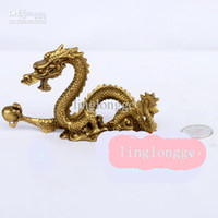 brass statue - a rare brass statue of the dragon is a mascot in China