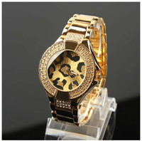 Wholesale New model round Leopard dial diamond fashion Luxury women watch gold amp silver famous logo table all over the world