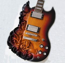 2013 SG tallaron la guitarra eléctrica del cráneo con color del resplandor solar del cuerpo de la ceniza Envío libre desde cuerpo sg proveedores