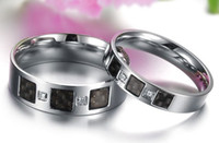 Wholesale 50 off The new carbon fiber inlay diamond jewelry quot Continuation of Love quot titanium steel couple rings style option pairs