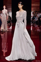 Reference Images Jewel/Bateau Chiffon 2014 Elie Saab Sheer Beaded And Leather Belts Sheath Bateau Neckline Long Sleeves Floor-Length Chiffon Evening Gowns Prom Dresses 20131010