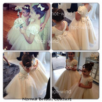 Wholesale Lovely Ivory Little Flower Girl Dresses Floor Length Scoop Short Puff Sleeves Bow Beautiful Tulle Girl s Formal Party Gowns BO2686