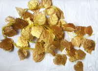 Wholesale 100pcs long Beautiful vine Ivy hanging bush plant Artificial gold leaf wedding party home garland decor wd004