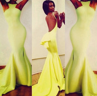 Model Pictures Jewel/Bateau Taffeta Nicole dramatic train cute peplum at the low back daring cutaway halterneck backless yellow Michael Costello Prom Evening Celebrity dresses