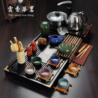 Wholesale Purple sand tea set special package mail four unity induction cooker solid wood tea tray kung fu tea set a complete set of your kiln ceramic