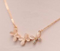 Wholesale korean style charms gold plated alloy man made opal rhinestone butterfly pendant Necklace