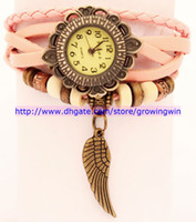 Wholesale 100pcs Vintage Bronze quartz watch Wings pendant pendant clock Ladies Leather strap wristwatches Hand woven bracelet ladies dress Watch
