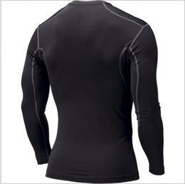 2017 capas base Las capas largas de la base de la compresión de los deportes del Mens PRO cubren la piel de las camisas de las camisas de los nuevos desgaste la nueva camisa rápida S M L XL XXL del deporte liberan el envío presupuesto capas base