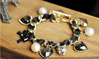 Wholesale Korean models fashion bow leopard peach heart pearl diamond bracelet
