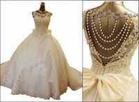 Wholesale 2014 New Bling Crystal Wedding Dresses Scoop Appliques Beads Backless Pearl Bows Ball Gown Court Train Lace Tulle Luxury Custom Bridal Gowns