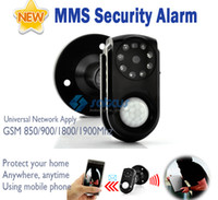 Wholesale Mini GSM MMS GPRS Alarm System PIR Motion Camera Wireless Security GSM Alarm Systems Infrared Night Vision TF Card APP Website Monitor