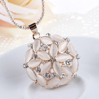Pendant Necklaces   hot hotKorean jewelry wholesale opal five leaf flower petals Diamond hollow ball pendant necklace long sweater chain pendant women010