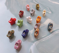 Wholesale Porcelain Beads mixed colors DIY accessories ceramic loose beads star design sold per bag of Model no