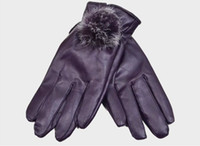 Wholesale Ms Winter new full PU leather gloves cute rabbit fur ball warm outdoor motorcycle plus velvet warm gloves