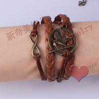 achat en gros de nouveaux designs faits main cadeaux-Cadeau de Noël Nouveaux oiseaux 3D faits main faits main chauds, une direction, conceptions de bracelet d'infini LM-L029 Shippng libre