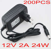 Wholesale 200pcs AC V to DC V A EU or US Plug AC DC Power adapter charger Power Supply Adapter for Led Strips Lights FREE