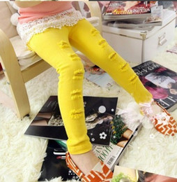 Wholesale new Beautiful spring hole child skinny pants pencil pants ploughboys