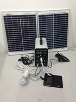 Wholesale 30w AH portable small solar home system charge DC led bulb lamp all mobile phone DC fan solar generator solar energy system