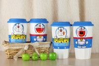 Wholesale Cartoon Doraemon ceramic mug silicone cup lid with non slip insulated sleeve grip and man made leather coaster