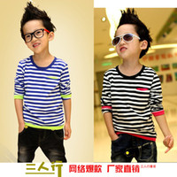 Wholesale Three rows of children s clothes spring new Korean T shirt boutique boys striped long sleeved shirt