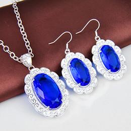 2017 bleu argent Vente en gros - Nouvelle arrivée 925 Sterling Silver Infinity Jewelry Set Blue Charm Topaz Pendentifs Boucles d'oreilles Z0116 bleu argent à vendre