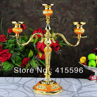 Wholesale New arrival gold plated white glue Candle Holder metal candlestick candles for wedding Religious Activities home decoration