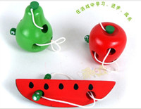 Wholesale Montessori teaching aids baby worms eat the fruit puzzle wooden toy safety and environmental protection channeling rope toys