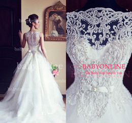 Wholesale 2016 Arabic Ball Gown Vintage Wedding Dresses Lace Crew Illusion Sleeveless Buttons Back Beaded Lace Sheer Beach Bridal Gowns with BowBO3039