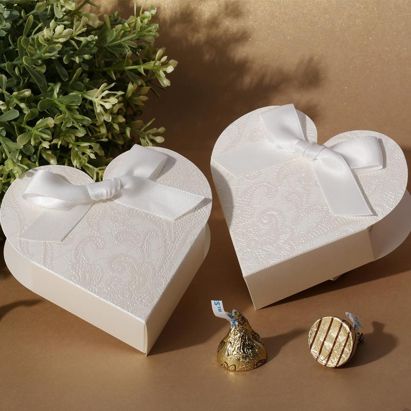 elegant white heart shaped embossed candy gifts chocolate favor boxes with bow for wedding party. Black Bedroom Furniture Sets. Home Design Ideas