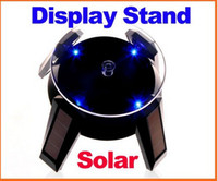 Wholesale Solar Powered Jewelry Phone Watch Rotating Display Stand Turn Table with LED Light Black amp Whie in retail box